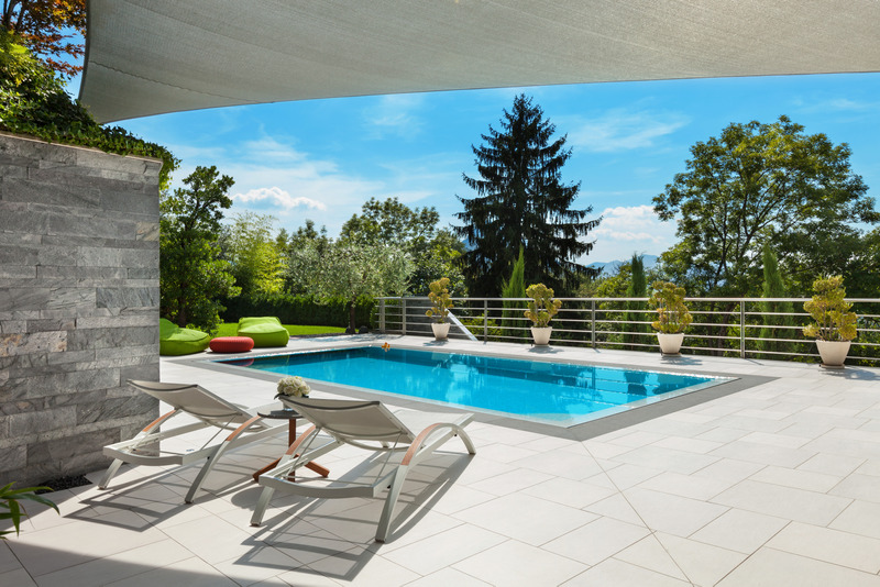 4 Ideas For Creating Versatile And Relaxing Poolside Areas This