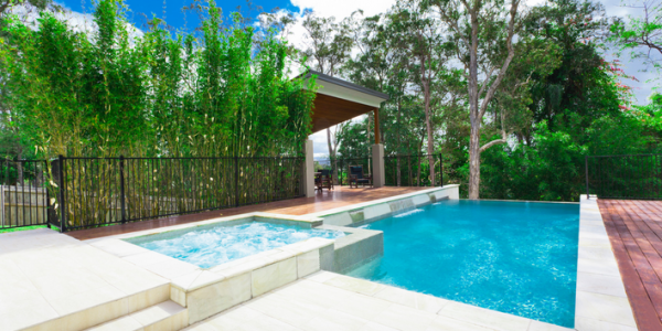 Beautiful natural stone surrounds and tile inlays for your pool